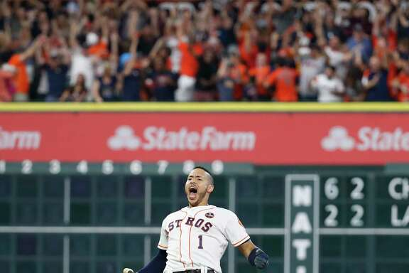 Carlos Correa reacts after his RBI double scored Jose Altuve with the winning run in the ninth inning of Game 2 of the ALCS at Minute Maid Park on Saturday.