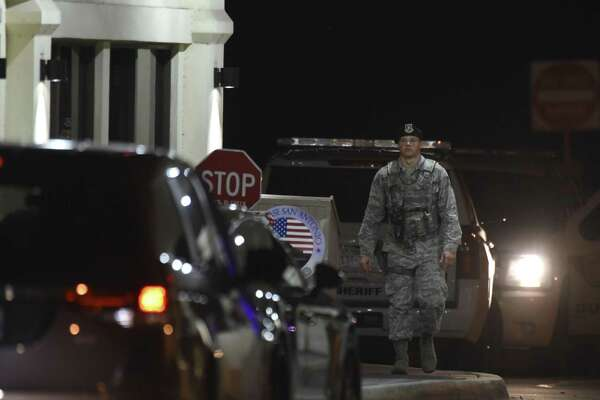 A sentry mans the front gate at Joint Base San Antonio- Randolph after a car crashed through a fence on the east side of the base and it was under a shelter-in- place order.