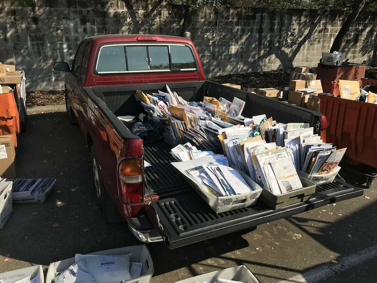 Mail belonging to evacuated victims of the deadly Tubbs Fire sits in the bed of a pickup truck in the back lot of a Santa Rosa post office on Oct. 14, 2017.