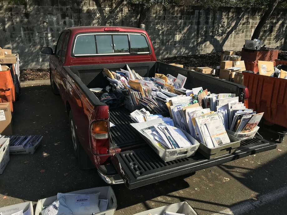 Mail belonging to evacuated victims of the deadly Tubbs Fire sits in the bed of a pickup truck in the back lot of a Santa Rosa post office on Oct. 14, 2017. Photo: Demian Bulwa