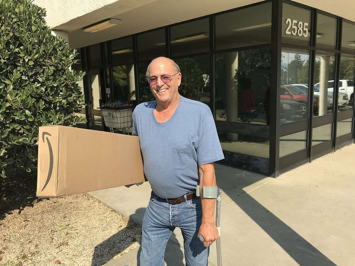 Ken Sparks, who was evacuated from his home in Larkfield, Calif., due to the deadly Tubbs Fire, picks up his mail five days later in Santa Rosa on Oct. 14, 2017.