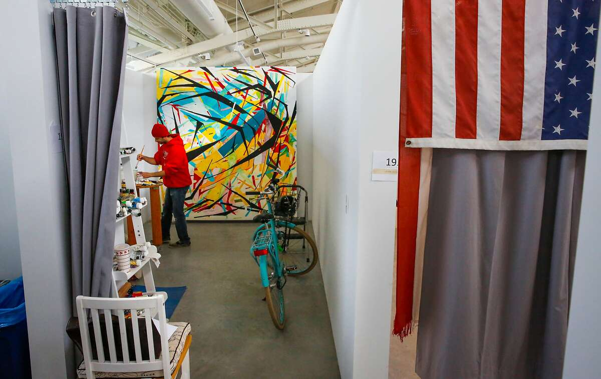 """First year student Marc Northstar works in his space on a mural he calls, Rosa"""" the new home of San Francisco Art Institute at Pier 2 in Fort Mason in San Francisco, as seen on Friday October 13, 2017."""