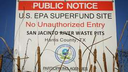 A sign warns the public about the EPA Superfund Site not to eat contaminated seafood caught from the water along Interstate 10 near the San Jacinto River east of Houston in Channelview.  ( Michael Paulsen / Houston Chronicle )