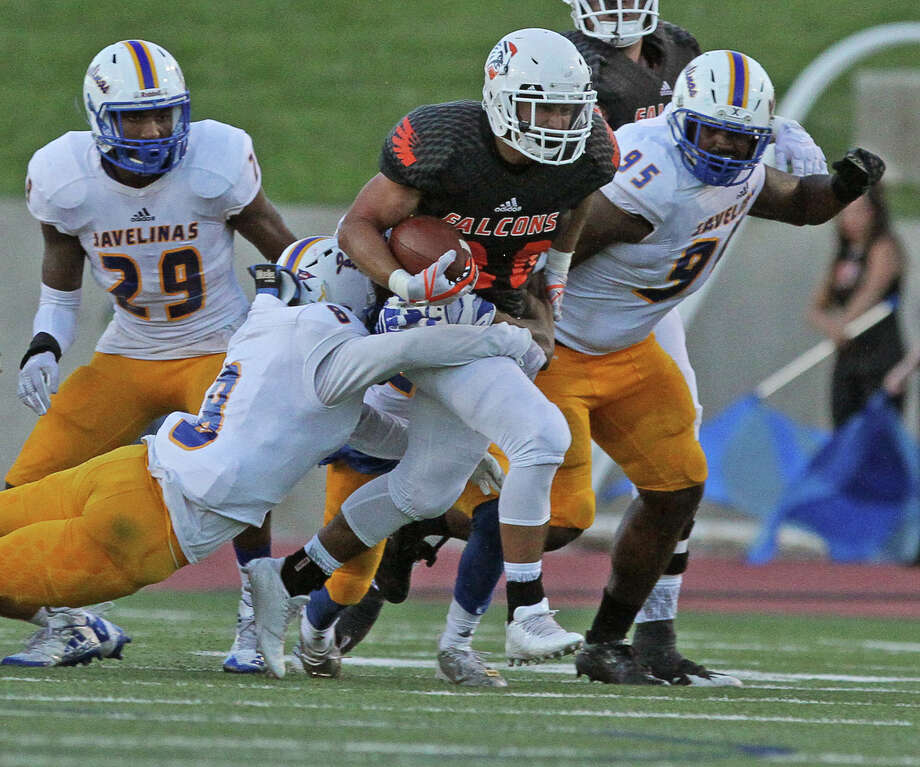 UTPB Falcons' Brandon Infiesto (28) runs for a gain as Texas A&M Kingsville Javelinas' Emond Hobbs (8) attempts a tackle during the second quarter Saturday night at Ratliff Stadium. Photo: Jacob Ford|Odessa American