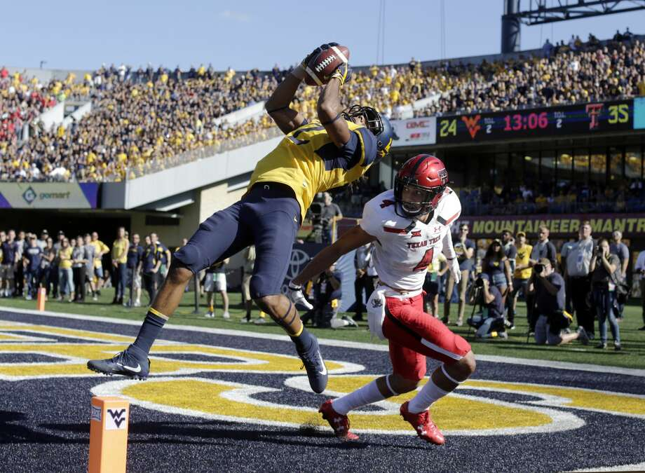West Virginia wide receiver Ka'Raun White (2) catches a touchdown pass in front of Texas Tech defensive back Desmon Smith (4) during the second half of an NCAA college football game, Saturday, Oct. 14, 2017, in Morgantown, W.Va. (AP Photo/Raymond Thompson) Photo: Ray Thompson/Associated Press
