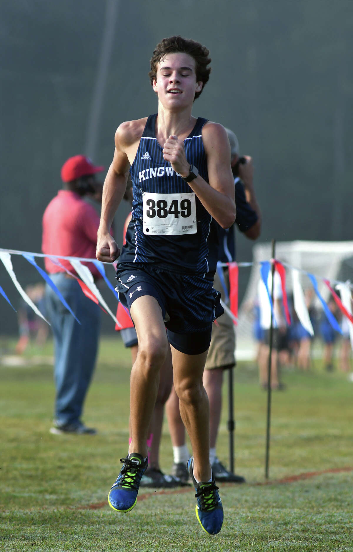 Kingwood's Nick Majerus pushes to the finish line during the Varsity Boys race at the District 21-6A Cross Country Championship at Atascocita High School on Oct. 13, 2017. (Photo by Jerry Baker/Freelance)