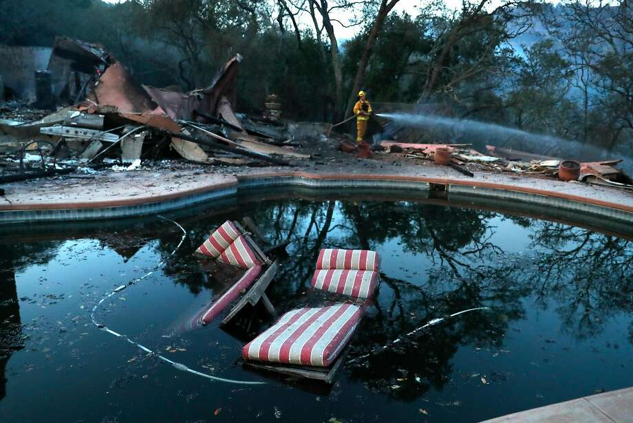 Petaluma firefighter Kevin Larsen extinguishes hot spots at a large home that burned in the Ranch subdivision in the city of Sonoma last month. Photo: Scott Strazzante, The Chronicle