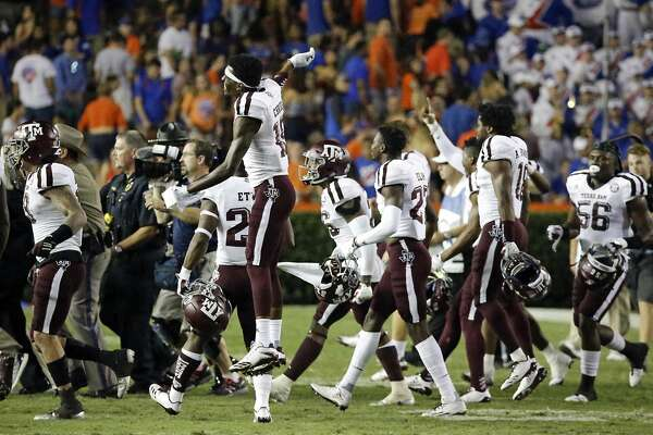 Texas A&M players celebrate as they run on the field after defeating Florida 19-17 in an NCAA college football game, Saturday, Oct. 14, 2017, in Gainesville, Fla. (AP Photo/John Raoux)