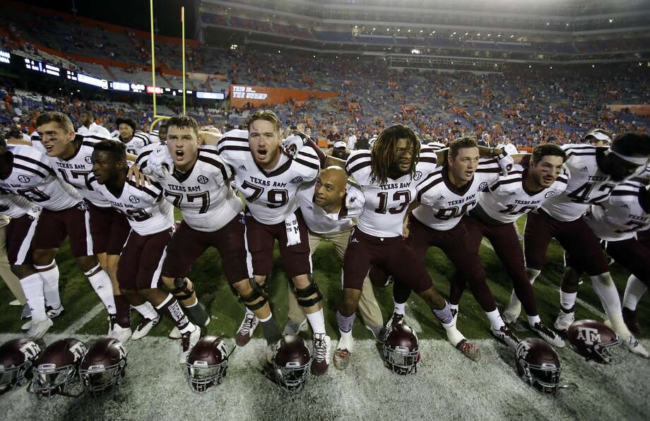 Texas A&M players sing and celebrate in front of fans after defeating Florida 19-17 in during in an NCAA college football game, Saturday, Oct. 14, 2017, in Gainesville, Fla (AP Photo/John Raoux) Photo: John Raoux/Associated Press