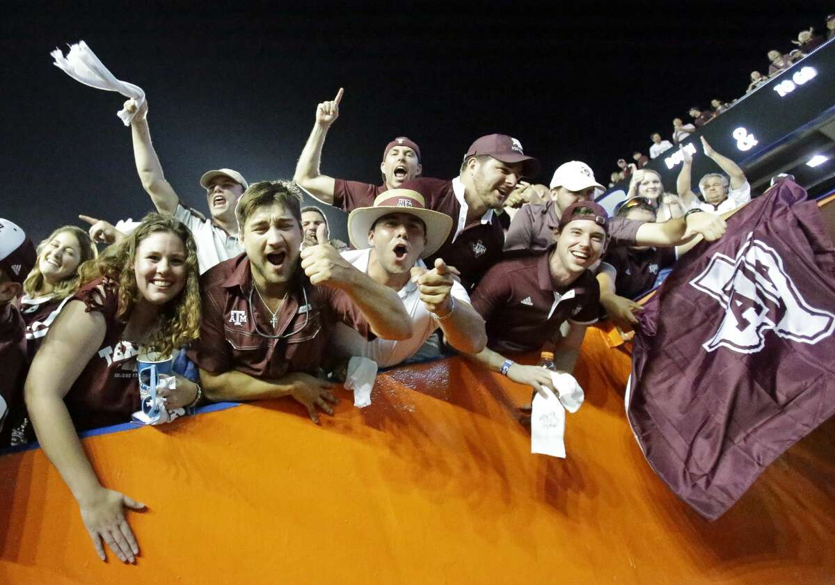 Texas A&M fans cheer players as they leave the field after their team defeated Florida 19-17 in an NCAA college football game, Saturday, Oct. 14, 2017, in Gainesville, Fla. (AP Photo/John Raoux)