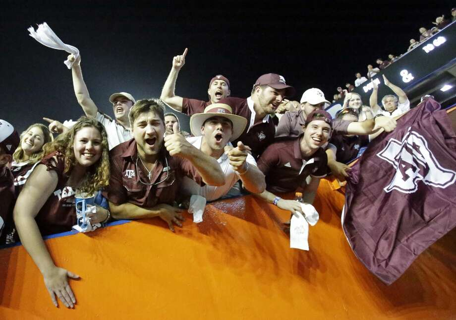 Texas A&M fans cheer players as they leave the field after their team defeated Florida 19-17 in an NCAA college football game, Saturday, Oct. 14, 2017, in Gainesville, Fla. (AP Photo/John Raoux) Photo: John Raoux/Associated Press