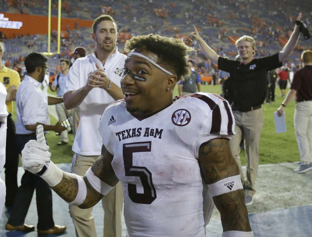 Texas A&M running back Trayveon Williams (5) gives the thumbs up to fans as he leaves the field after defeating Florida 19-17 in an NCAA college football game, Saturday, Oct. 14, 2017, in Gainesville, Fla. (AP Photo/John Raoux)