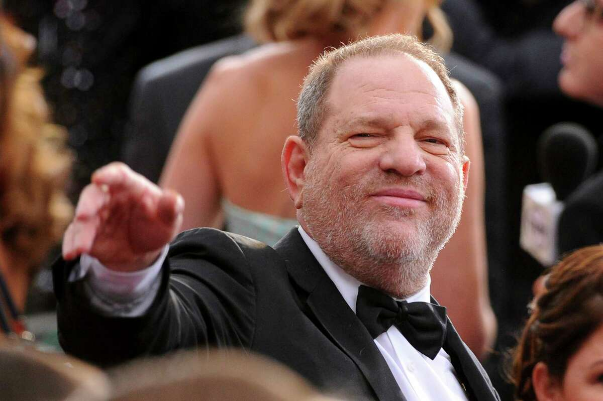 FILE- In this Feb. 22, 2015 file photo, Harvey Weinstein arrives at the Oscars at the Dolby Theatre in Los Angeles. On Saturday, Oct. 14, 2016, the Academy of Motion Picture Arts and Sciences revoked Weinstein's membership. The decision, reached Saturday in an emergency session, comes in the wake of recent reports by The New York Times and The New Yorker magazine that revealed sexual harassment and rape allegations against him going back decades.(Photo by Vince Bucci/Invision/AP, File) ORG XMIT: NYR102