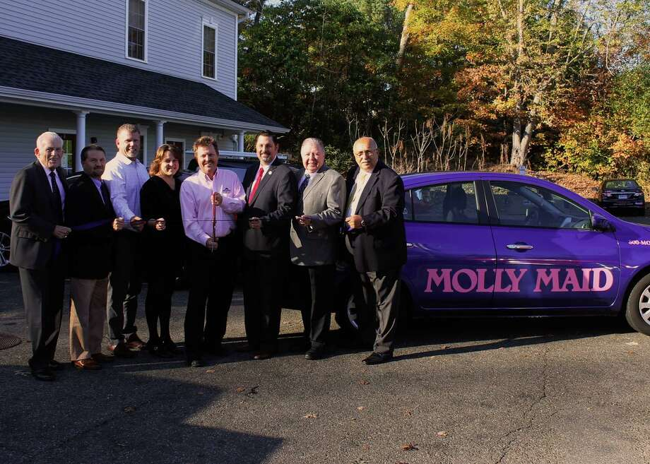 Molly Maid of Central CT held a grand opening on Oct. 12 at 40 Country Squire Drive in Cromwell. From left: Middlesex County Chamber of Commerce President Larry McHugh, Middlesex County Chamber of Commerce Chairman Rick Morin, Chairman of the Cromwell Division of the Middlesex County Chamber of Commerce Rodney Bitgood, owners Renee and Bill Lacourciere, Cromwell Mayor Enzo Faienza, Middlesex County Chamber of Commerce Vice Chairman Jay Polke and Cromwell Town Manager Anthony Salvatore. Photo: Contributed