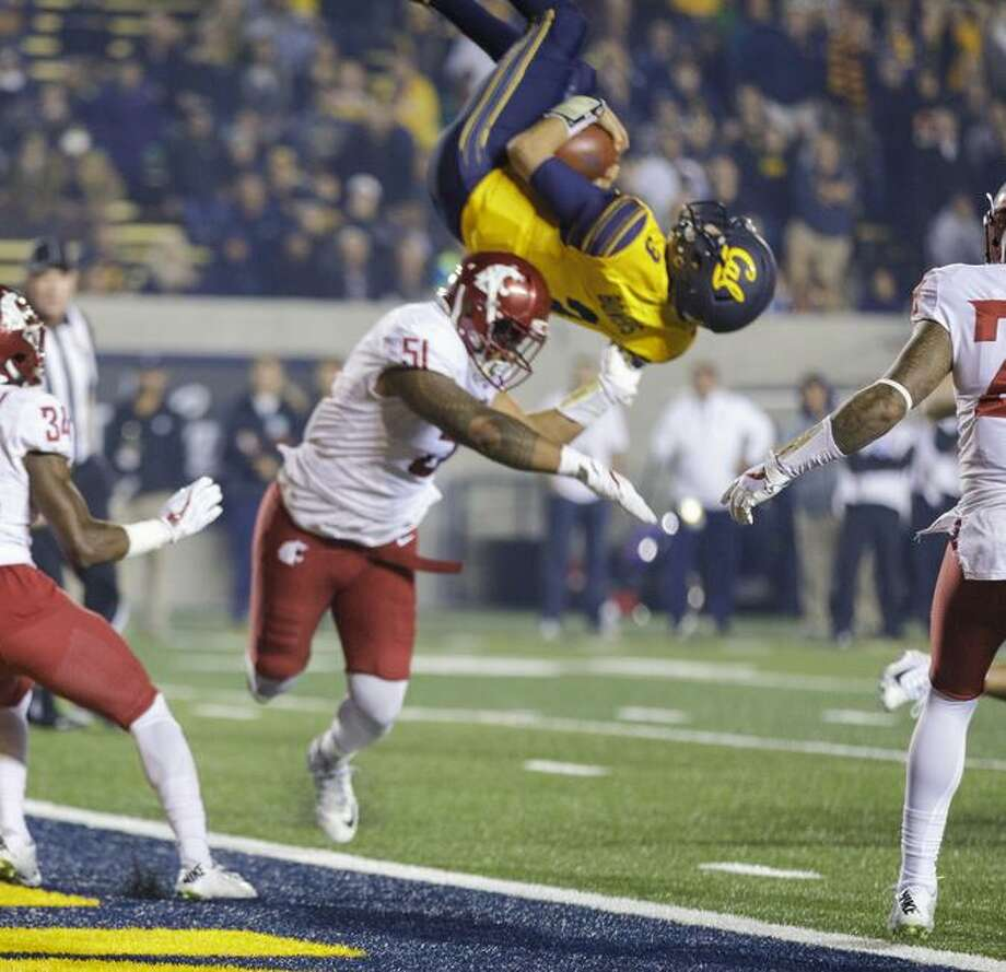 Cal quarterback Ross Bowers   begins a somersault into the end zone. His fourth-quarter TD gave the Bears a 27-3 lead over Washington State — and got Bowers a ton of attention. Photo: Nathan Phillips / Nathan Phillips- KLC Fotos / Nathan Phillips