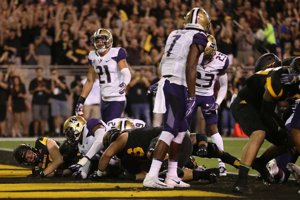 Running back Kalen Ballage #7 of the Arizona State Sun Devils dives into the endzone to score on a one yard rushing touchdown against the Washington Huskies during the first half of the college football game at Sun Devil Stadium in Tempe, Arizona, on Oct. 14, 2017.
