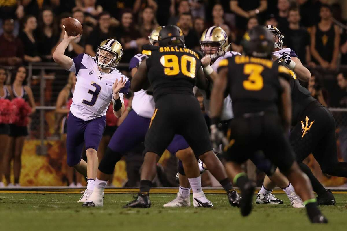 Quarterback Jake Browning #3 of the Washington Huskies throws a pass during the first half of the college football game against the Arizona State Sun Devils at Sun Devil Stadium in Tempe, Arizona, on Oct. 14, 2017.