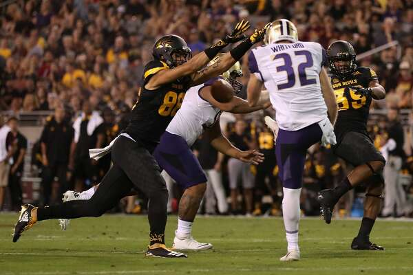 Wide receiver Curtis Hodges #86 of the Arizona State Sun Devils blocks a kick from punter Joel Whitford #32 of the Washington Huskies during the first half of the college football game at Sun Devil Stadiumin Tempe, Arizona, on Oct. 14, 2017.