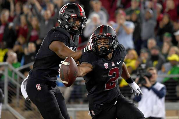 PALO ALTO, CA - OCTOBER 14:  Brandon Simmons #2 and Justin Reid #8 of the Stanford Cardinal celebrates after Simmons picks up the ball and scores a touchdown after a blocked punt against the Oregon Ducks during the second quarter of their NCAA football game at Stanford Stadium on October 14, 2017 in Palo Alto, California.  (Photo by Thearon W. Henderson/Getty Images)