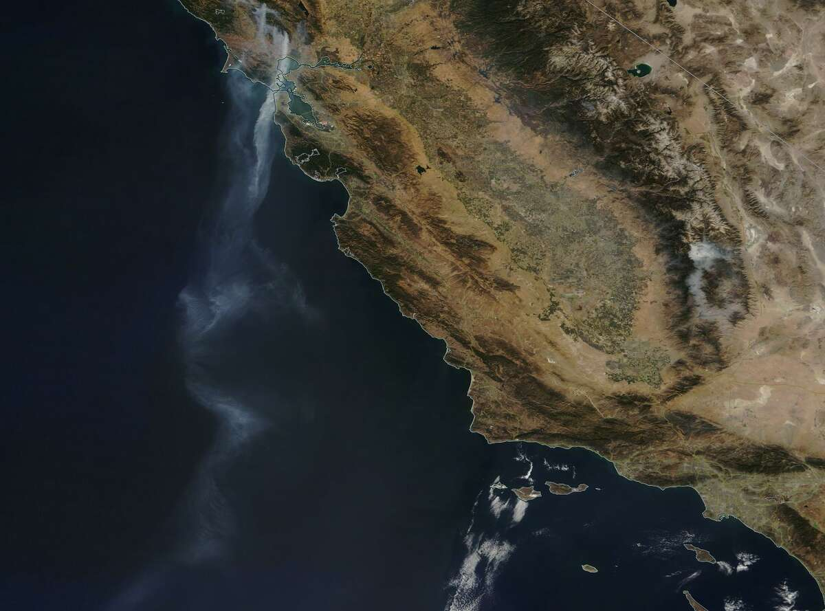 Aerial photos show smoke from the Wine Country fires billowing into the Pacific Ocean and traveling as far south as Mexico on Friday, Oct. 13.