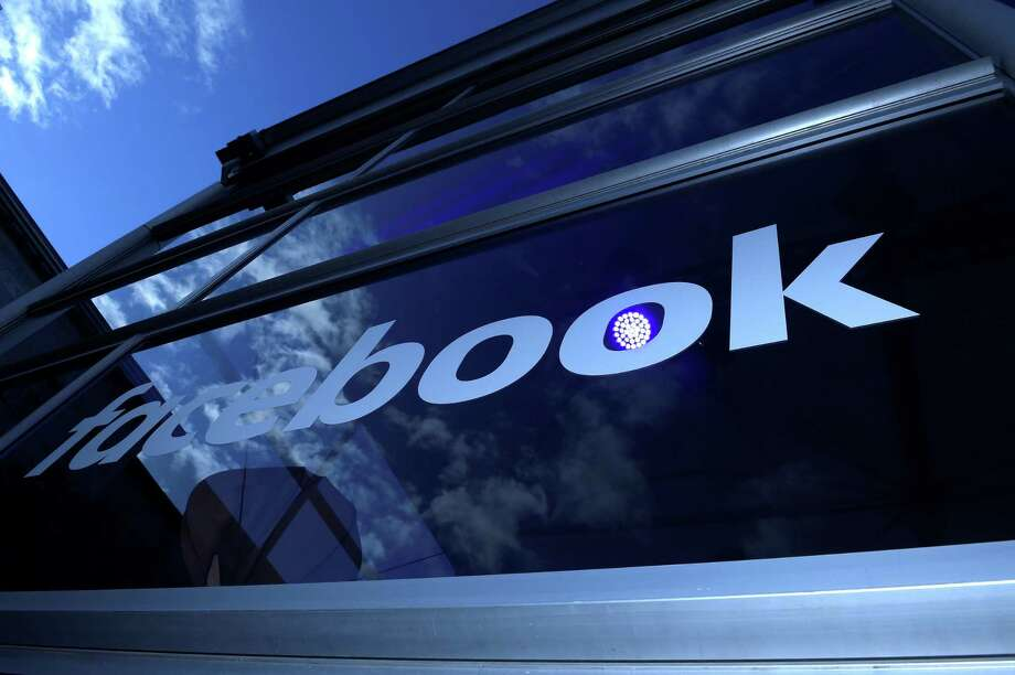 "(FILES) This file photo taken on February 24, 2016 shows the ""Facebook"" logo on the sidelines of a press preview of the so-called ""Facebook Innovation Hub"" in Berlin. Facebook on October 13, 2017 announced a new feature to make it easier for users to order meals from nearby restaurants and service providers without leaving the social network. A new ""order food"" feature rolled out for US users lets Facebook users order delivery or takeout from restaurant chains such as Papa John's and Panera, and on-demand services including Delivery.com and DoorDash.  / AFP PHOTO / TOBIAS SCHWARZTOBIAS SCHWARZ/AFP/Getty Images Photo: TOBIAS SCHWARZ / AFP/Getty Images / AFP or licensors"