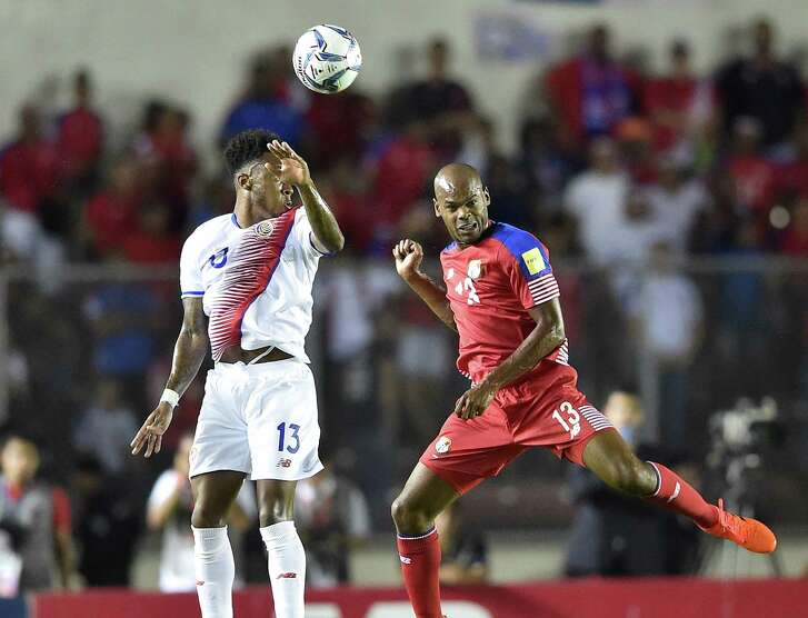 Costa Rica's Rodney Wallace and Panama's Adolfo Machado vie for the ball during their 2018 World Cup qualifier football match in Panama City, on October 10, 2017. / AFP PHOTO / Rodrigo ARANGUARODRIGO ARANGUA/AFP/Getty Images