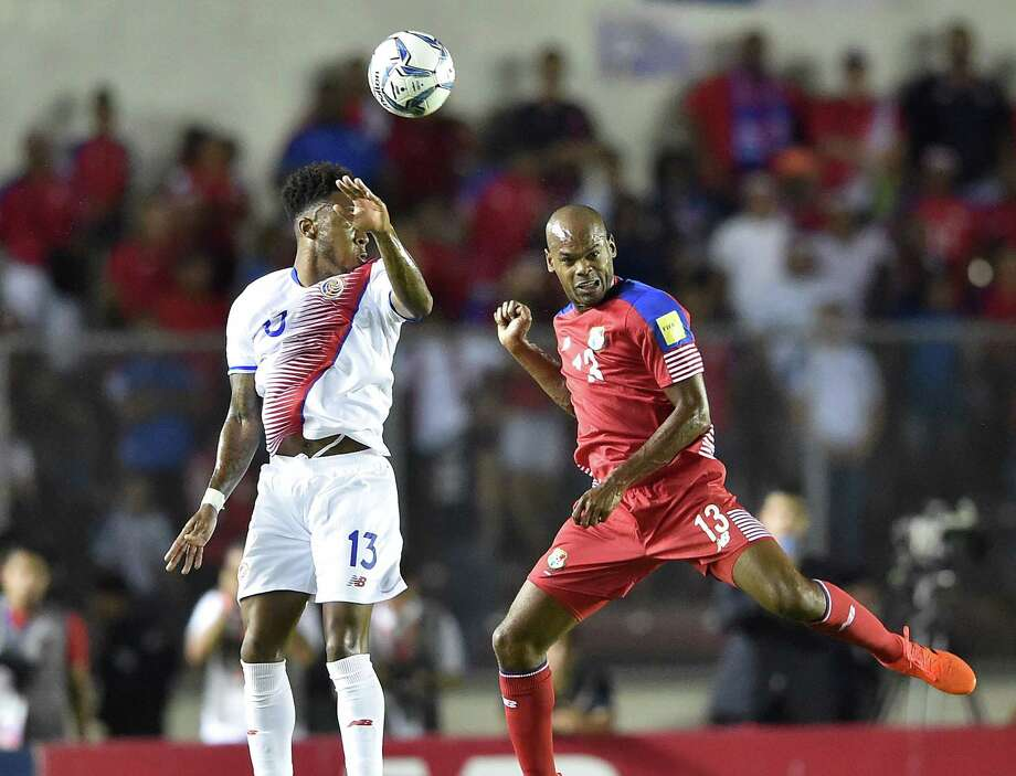 Costa Rica's Rodney Wallace and Panama's Adolfo Machado vie for the ball during their 2018 World Cup qualifier football match in Panama City, on October 10, 2017. / AFP PHOTO / Rodrigo ARANGUARODRIGO ARANGUA/AFP/Getty Images Photo: RODRIGO ARANGUA, AFP/Getty Images / AFP or licensors