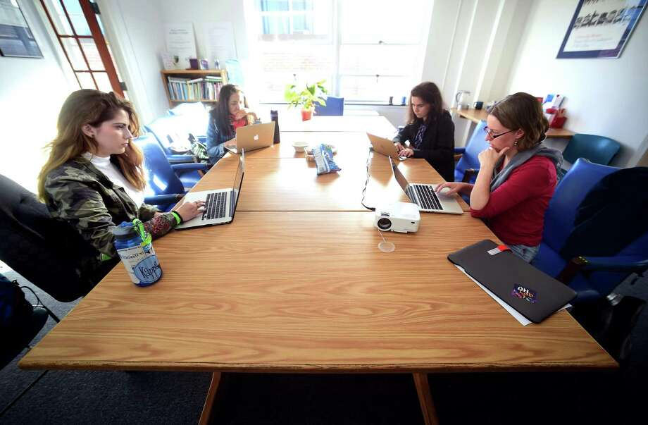 Left to right, Yale University undergraduate Adrianne Owings, Najwa Mayer, research fellow at the Yale Women Faculty Forum, Emily Stark, post grad associate at the Yale Women Faculty Forum, and Claire Bowern, chair of the Yale Women Faculty Forum, participate in a Wikipedia Editathon at the offices of the Yale Women Faculty Forum in New Haven on October 13, 2017. Photo: Arnold Gold / Hearst Connecticut Media / New Haven Register