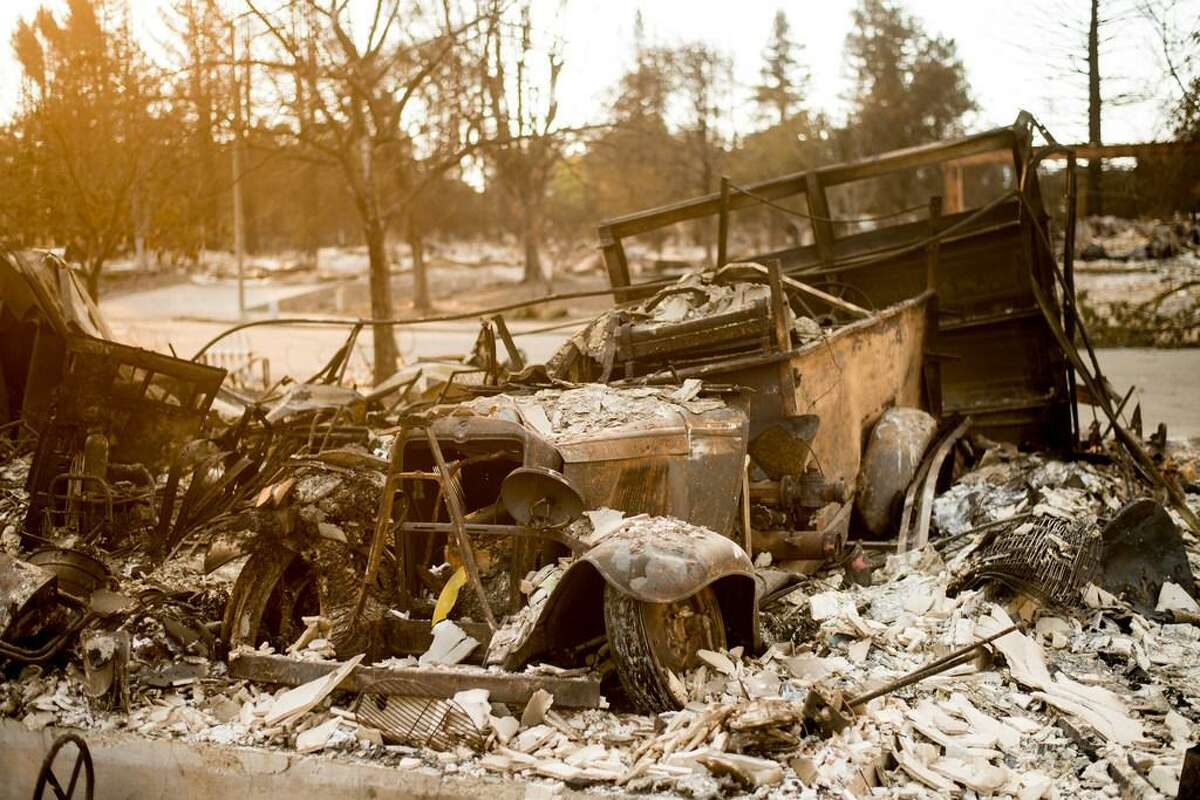 Tony Niel's vintage 1929 chevy fire engine, burned during the Tubbs fire, rests amid rubble on Thursday, Oct. 12, 2017, in Santa Rosa.