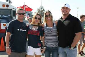 Houston Texans fans pose for a photo outside of NRG Stadium before the team teaks on Cleveland Browns for a NFL game Sunday, Oct. 15, 2017, in Houston.