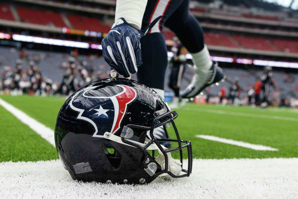 Houston Texans nose tackle D.J. Reader places his mouthguard onto of his helmet while warming up before an NFL football game against the Cleveland Browns at NRG Stadium on Sunday, Oct. 15, 2017, in Houston.