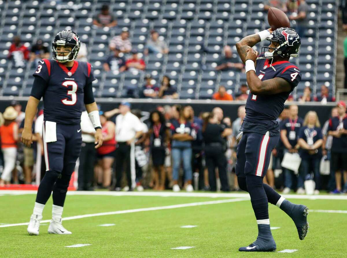 Houston Texans quarterbacks Tom Savage (3) and Deshaun Watson (4) warm up before an NFL football game against the Cleveland Browns at NRG Stadium on Sunday, Oct. 15, 2017, in Houston.