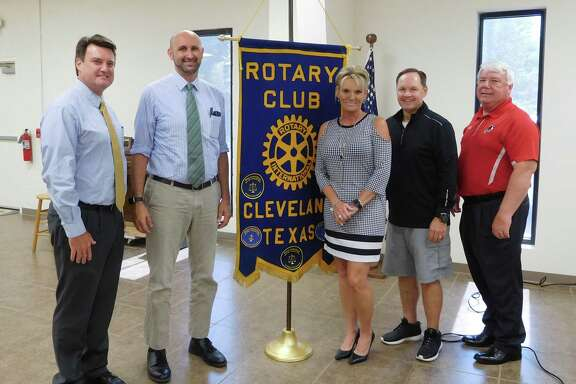 Pictured left to right are Claycomb Associates Architect speakers VP Richard Crumb and Will Clayton; Rotarian and speaker host Kelly Jenkel-Axton, Rotary President Scott Lambert, and Rotarian and Cleveland ISD Superintendent Darrell Myers.