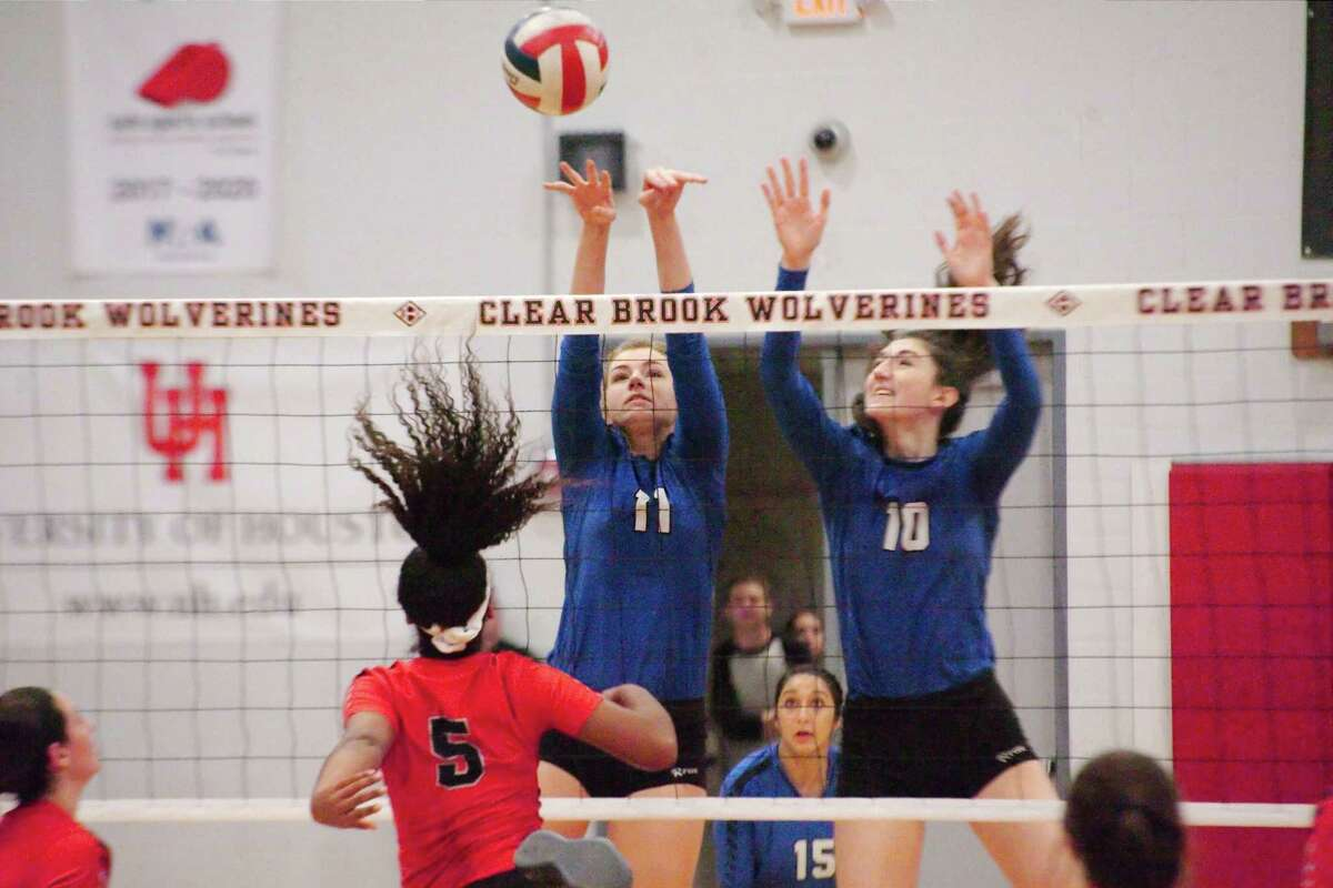 Friendswood's Faith Marabella (11) and Friendswood's Mckenna Fridye (10) put up a block in front of Clear Brook's Kailin Newsome (5) in a District 24-6A volleyball match.