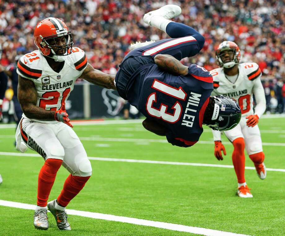 Houston Texans wide receiver Braxton Miller (13) flips into the end zone past Cleveland Browns cornerback Jamar Taylor (21) for a 1-yard touchdown reception during the second quarter of an NFL football game at NRG Stadium on Sunday, Oct. 15, 2017, in Houston. Photo: Brett Coomer, Houston Chronicle / © 2017 Houston Chronicle