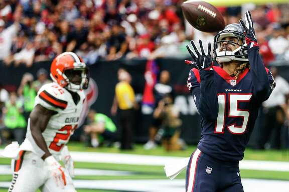 Houston Texans wide receiver Will Fuller (15) beats Cleveland Browns free safety Jabrill Peppers (22) for a 39-yard touchdown reception from quarterback Deshaun Watson during the first quarter of an NFL football game at NRG Stadium on Sunday, Oct. 15, 2017, in Houston.
