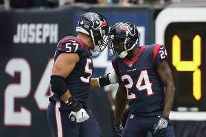 Houston Texans cornerback Johnathan Joseph (24) and linebacker Brennan Scarlett (57) celebrate Joseph's interception and touchdown during the second quarter of an NFL football game at NRG Stadium on Sunday, Oct. 15, 2017, in Houston.