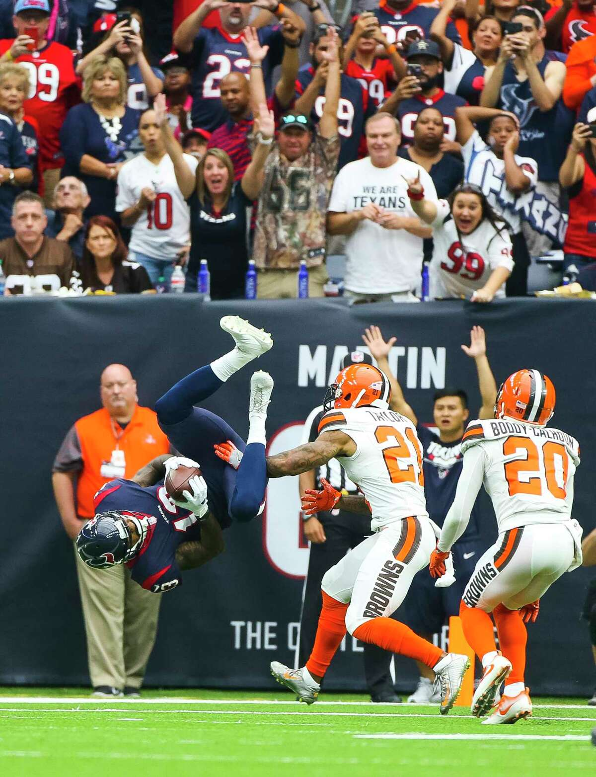 Houston Texans wide receiver Braxton Miller (13) flips into the end zone on a one-yard touchdown reception during the first half of an NFL football game at NRG Stadium on Sunday, Oct. 15, 2017, in Houston.