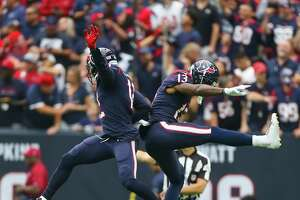 Houston Texans wide receiver Braxton Miller (13) and wide receiver Bruce Ellington (12) celebrate Miller's touchdown during the first half of an NFL football game at NRG Stadium on Sunday, Oct. 15, 2017, in Houston.