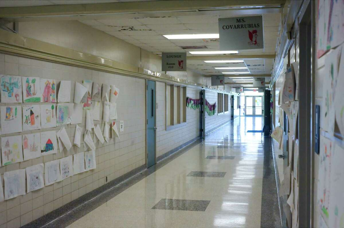 Narrow tiled hallways show their age at Red Bluff Elementary School, which was built in 1954.