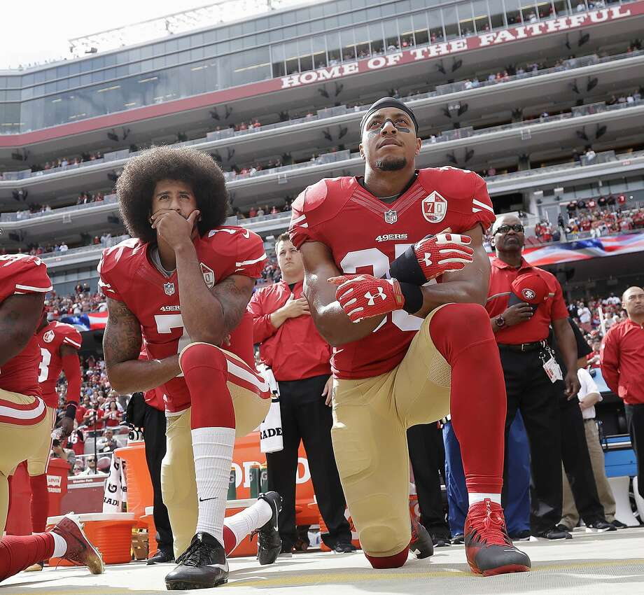 In this Oct. 2, 2016 file photo, San Francisco quarterback Colin Kaepernick, left, and safety Eric Reid kneel during the national anthem before an NFL football game against the Dallas Cowboys in Santa Clara, Calif.  The 49ers won't be forcing their players to stand during the national anthem, safety Eric Reid said Wednesday, Oct. 11, 2017. Photo: Marcio Jose Sanchez, Associated Press