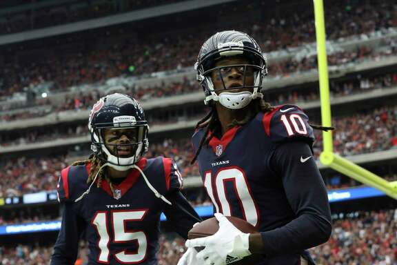 Houston Texans wide receiver Will Fuller (15) congratulates DeAndre Hopkins (10) for his touchdown during the third quarter of an NFL football game at NRG Stadium on Sunday, Oct. 15, 2017, in Houston.
