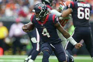 Houston Texans quarterback Deshaun Watson (4) carries the ball during the fourth quarter of an NFL football game at NRG Stadium on Sunday, Oct. 15, 2017, in Houston. Houston Texans defeated Cleveland Browns 33-17.
