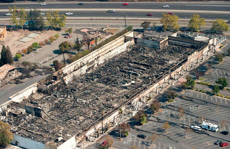 An aerial view shows a burned K-Mart store in Santa Rosa. Sonoma County has advised residents about existing laws forbidding price gouging after a disaster has been declared by state or federal authorities. Photo: JOSH EDELSON, AFP/Getty Images
