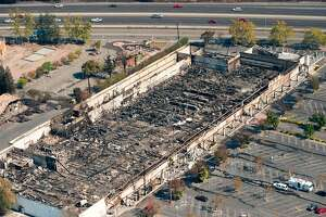 An aerial view shows a burned K-Mart retail store in Santa Rosa, California on October 12, 2017.  Hundreds of people are still missing in massive wildfires which have swept through California killing at least 26 people and damaging thousands of homes, businesses and other buildings. / AFP PHOTO / JOSH EDELSONJOSH EDELSON/AFP/Getty Images