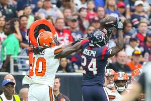 Houston Texans cornerback Johnathan Joseph (24) catches his second interception of the day over Cleveland Browns wide receiver Sammie Coates (10) during the first half of an NFL football game at NRG Stadium on Sunday, Oct. 15, 2017, in Houston.