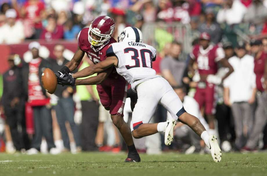 UConn freshman Jordan Swann, right, breaks up a pass intended for Ventell Bryant during Saturday's game against Temple. Photo: Mitchell Leff / Getty Images / 2017 Getty Images