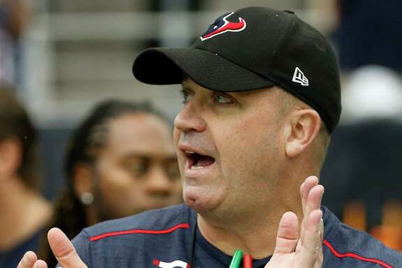 Houston Texans head coach Bill O'Brien claps as he gets his team ready for first quarter of an NFL football game against the Cleveland Browns at NRG Stadium on Sunday, Oct. 15, 2017, in Houston.