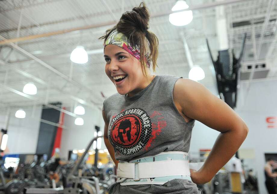 Jessica Hayduk, of Trumbull, puts on her weightlifting belt in preparation for a set of deadlifts at the Edge Fitness Club in Shelton, Conn on Thursday, October 12, 2017. Hayduk appears on Steve Austin's Broken Skull Challenge, a fitness competition show on CMT that will air on October 17 at 10 p.m. Photo: Brian A. Pounds / Hearst Connecticut Media / Connecticut Post