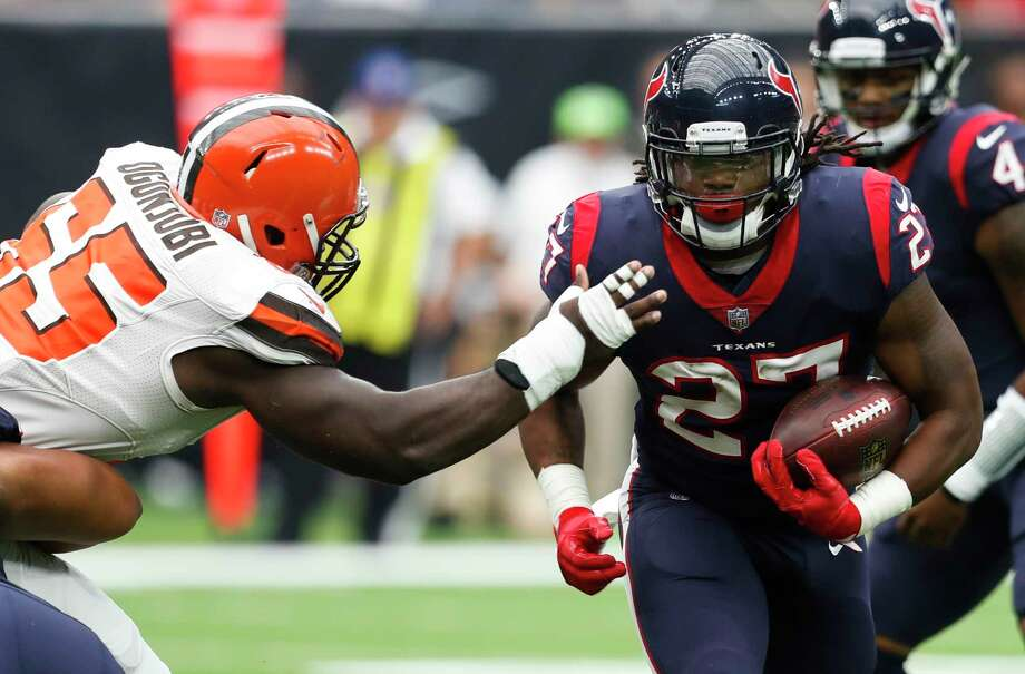 PHOTOS: Texans vs. Broncos  Houston Texans running back D'Onta Foreman (27) breaks away from Cleveland Browns defensive tackle Larry Ogunjobi (65) during the second quarter of an NFL football game at NRG Stadium on Sunday, Oct. 15, 2017, in Houston.  >>>See the Texans in actions against the Broncos on Sunday, Nov. 4, 2018 ...  Photo: Brett Coomer, Houston Chronicle / © 2017 Houston Chronicle